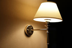 Glowing lamp on the wall in hallway Royalty Free Stock Photography