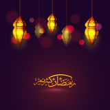 Glowing Lamps with Arabic text for Ramadan Kareem. Creative glowing hanging Lamps with Golden Arabic Islamic Calligraphy of text Ramadan Kareem, Elegant Royalty Free Stock Photos