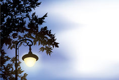 Glowing lantern, surrounded by maple branches Royalty Free Stock Photo
