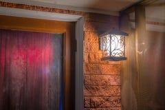 Glowing lantern on wall Royalty Free Stock Image