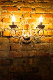 Glowing lantern on the wall Stock Images