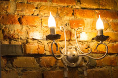 Glowing lantern on the wall Royalty Free Stock Photography