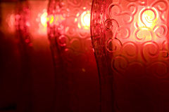 Glowing lanterns. Ornamental glass of lanterns (votive candle Royalty Free Stock Image