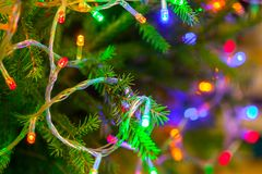 The glowing lanterns on the branches of the Christmas tree. Festive background royalty free stock photos