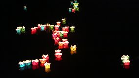 Glowing lanterns floating on the river  in the Hoi An  city, Vietnam stock video footage