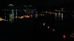 Glowing lanterns floating on the river  in the Hoi An  city, Vietnam stock video