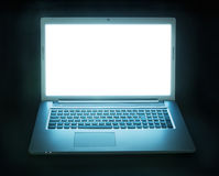Glowing laptop. Laptop computer with screen glowing in the dark Royalty Free Stock Photography