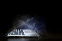 Glowing laptop device. Mixed media Royalty Free Stock Images