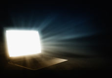 Glowing laptop Stock Photography