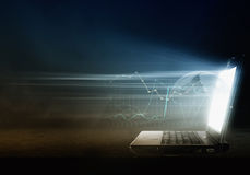 Glowing laptop Royalty Free Stock Images