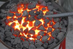 Glowing lava in the grate of the blacksmith Royalty Free Stock Images