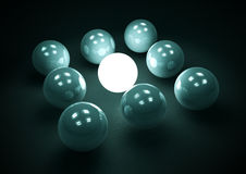 Glowing leader ball f1s. One outstanding element in a group Royalty Free Stock Photography