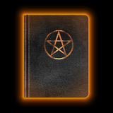 Glowing Leather Book With Pentagram Royalty Free Stock Image