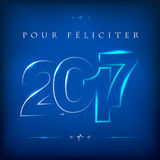 Glowing lettering 2017 on blue background. Greeting card for New Year 2017. Happy New Year 2017. Vector illustration Stock Images