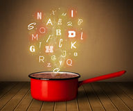 Glowing letters coming out from cooking pot Stock Images