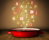 Glowing letters coming out from cooking pot Royalty Free Stock Photography