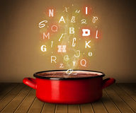 Glowing letters coming out from cooking pot Royalty Free Stock Images