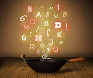 Glowing letters coming out from cooking pot Royalty Free Stock Image