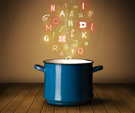 Glowing letters coming out from cooking pot Stock Photos