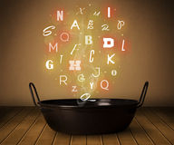 Glowing letters coming out from cooking pot Royalty Free Stock Photo
