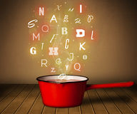 Glowing letters coming out from cooking pot Royalty Free Stock Photos