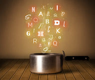 Glowing letters coming out from cooking pot. Colorful letters coming out from cooking pot Royalty Free Stock Photography