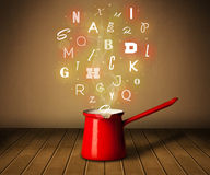 Glowing letters coming out from cooking pot. Colorful letters coming out from cooking pot Royalty Free Stock Image