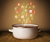 Glowing letters coming out from cooking pot. Colorful letters coming out from cooking pot Royalty Free Stock Photos