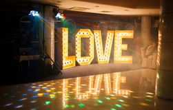 Glowing letters Love made of light bulbs. Love word made of glowing light bulbs. Copy space text Royalty Free Stock Photography