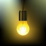 Glowing light bulb. In the dark royalty free illustration