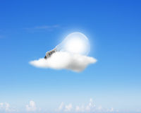 Glowing light bulb on clouds Royalty Free Stock Photos