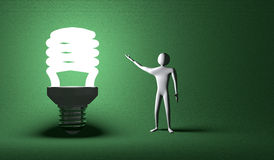 Glowing light bulb and 3d man on green Stock Photos