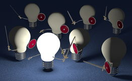 Glowing light bulb fighting against many switched off ones on blue Stock Photography