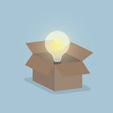 Glowing light bulb float over opened box, Thinking outside the b Royalty Free Stock Image