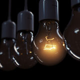 Glowing light bulb illuminating other ones Royalty Free Stock Image