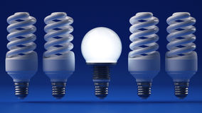 Glowing light bulb illuminating other ones Royalty Free Stock Photography