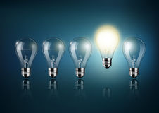 Glowing light bulb is among a lot of turned off light bulbs on dark blue background , concept idea , Transparent Vector stock illustration