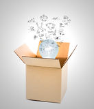 Glowing light bulb over open cardboard box Royalty Free Stock Images