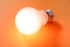Glowing light bulb turned on Royalty Free Stock Image