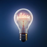 Glowing light bulb with the word idea Royalty Free Stock Photo