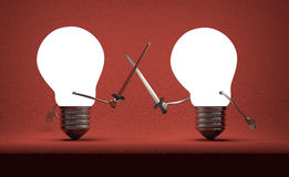 Glowing light bulbs fighting duel on red Royalty Free Stock Photography