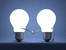 Glowing light bulbs handshaking on blue Stock Photos