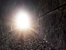 Glowing light at the end of the tunnel. Concept, metaphor. Stock Image