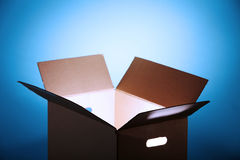 Glowing  light from open box Stock Photo