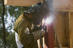 Glowing light of welder welding steel beam Royalty Free Stock Image