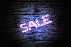 Glowing word `SALE` on brick wall stock illustration