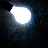 Glowing lightbulb Stock Photo