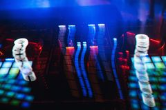 Glowing lights from DJ mixer music remote. Buttons stock image