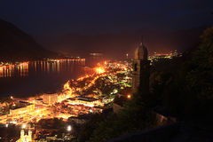 Glowing lights of night city in mountains Stock Image