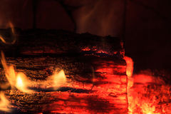 Glowing Log in a Dying Fire Royalty Free Stock Image